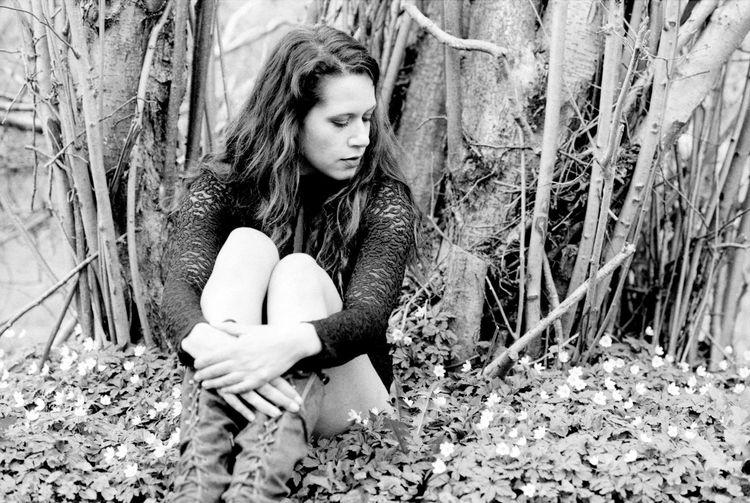 Teenage girl in a tree