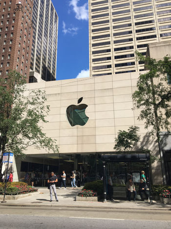 Apple Architecture Building Exterior Built Structure Car City Day Growth Men Modern Outdoors People Real People Sky Skyscraper Tree Walking
