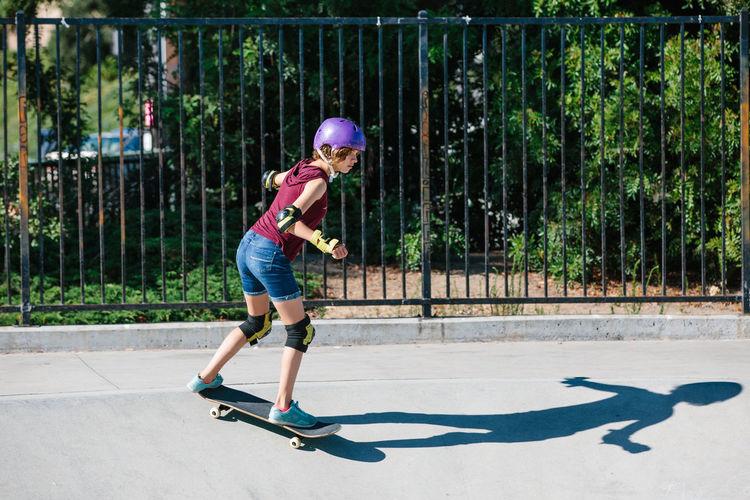 Full length of boy skateboarding on skateboard