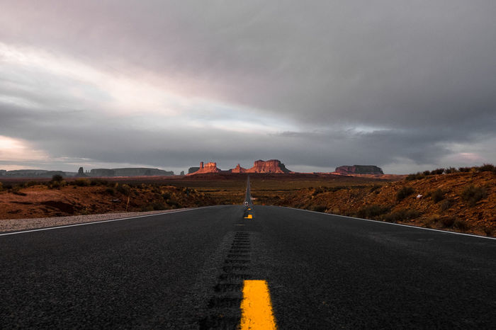 Good morning, Monument Valley. Did you sleep well? Adventure Arizona Beauty In Nature Classic Cloud - Sky Day Desert Empty Road Forrest Gump Fujifilm Kissed By The Sun Landscape Monument Valley Nature No People Outdoors Road Roadtrip Sunrise The Road The Way Forward Travel Photography Traveling USA Xt10