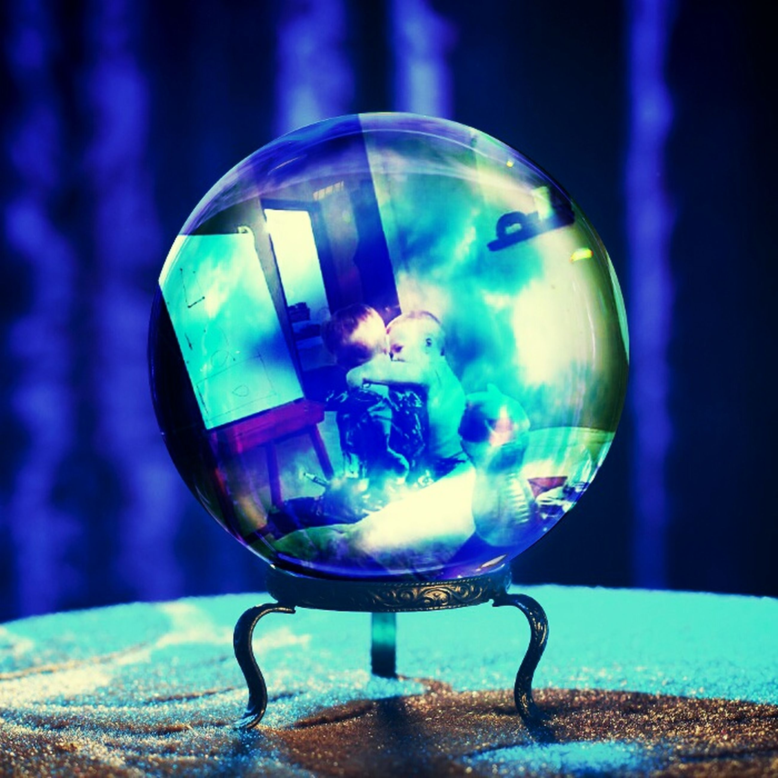 blue, close-up, illuminated, focus on foreground, glass - material, lighting equipment, indoors, transparent, sphere, night, reflection, shiny, metal, circle, single object, no people, sunlight, light - natural phenomenon