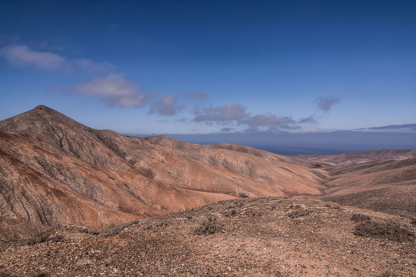 Fuerteventura Arid Climate Beauty In Nature Day Depression - Land Feature Desert Geology Kanarische Inseln Landscape Mountain Mountain Range Nature No People Outdoors Physical Geography Scenics Sky Tranquil Scene Tranquility