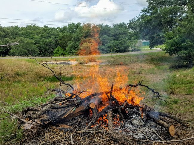 Burning Brush in-between the Rains Burning Flame No People Outdoors Summer Texas Hill Country Ranch Land Rural Scene Texas Made No Edit/no Filter Landscape Beauty In Nature