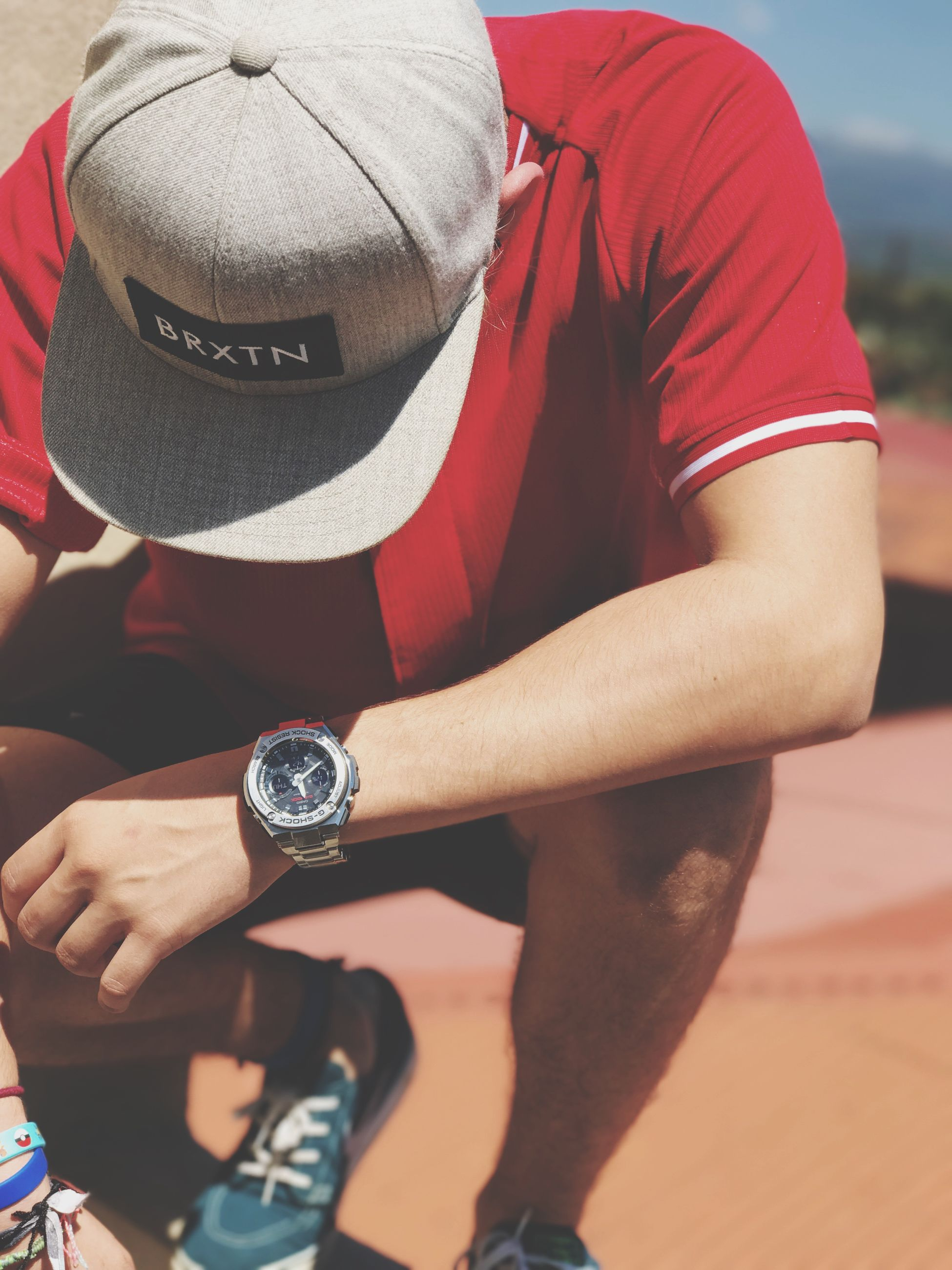 sport, sports clothing, red, real people, sportsman, one person, athlete, sports training, men, competition, outdoors, ball, wristband, only men, day, adults only, track and field, adult, people