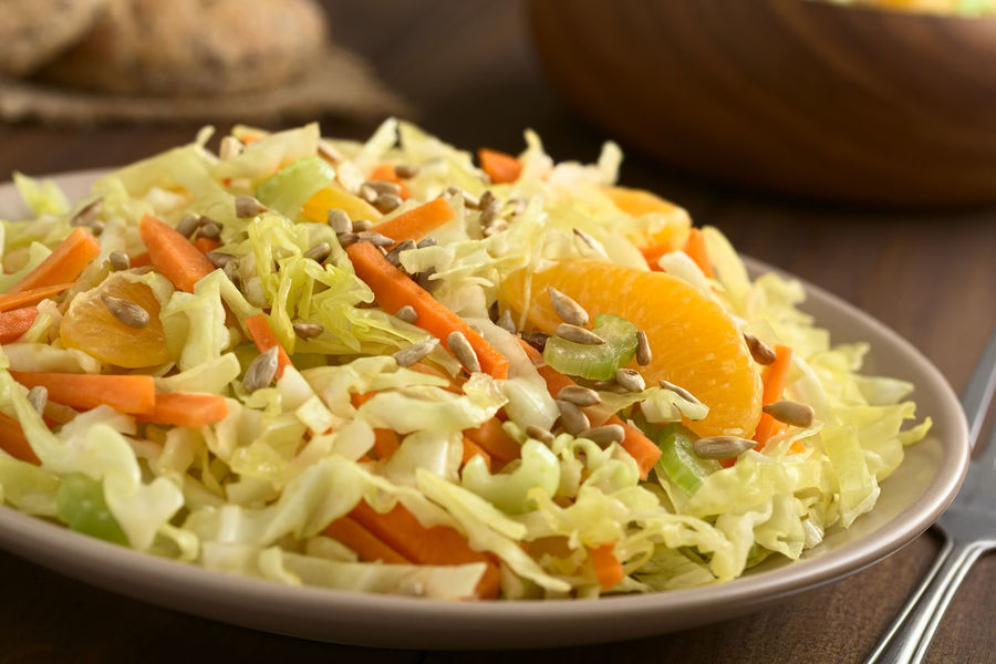 Fresh salad made of savoy cabbage, carrot, celery, and orange with roasted sunflower seeds on top, photographed with natural light (Selective Focus, Focus one third into the salad) Chopped Homemade Orange Raw Seed Vegetarian Vegetarian Food Cabbage Carrot Celery Citrus Fruit Cruciferous Food Food And Drink Freshness Fruit Healthy Eating Meal Raw Food Ready-to-eat Salad Savoy Cabbage Sunflower Seeds Vegan Vegetable