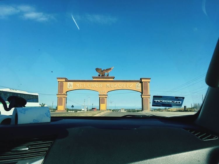 January 18 Work Welcome Portal Architecture Transportation Built Structure Car Travel Mode Of Transport Day Blue Sky Travel Destinations History Statue Sculpture Land Vehicle No People Architectural Column Outdoors