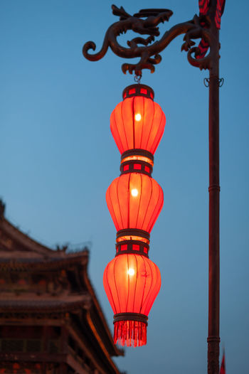 chinese lantern Illuminated Lighting Equipment Architecture Built Structure Sky Red No People Building Exterior Low Angle View Clear Sky Nature Lantern Dusk Blue Hanging Outdoors Travel Destinations Building Focus On Foreground Architectural Column
