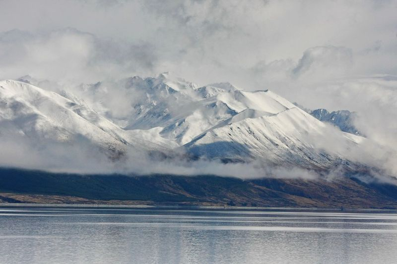 very beautiful mountain of snow Water Mountain Cold Temperature Beauty In Nature Snow Sky Winter Scenics - Nature Environment Cloud - Sky Nature Lake Landscape Tranquility Day No People Waterfront Tranquil Scene Ice Outdoors Snowcapped Mountain Mountain Peak Range Newzealand Travel