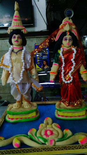 A Bengali Bride &Groom Completely made of SANDESH,a Traditional Bengali Sweet Street Photography Statue Religion Male Likeness Art And Craft Sculpture Spirituality Human Representation