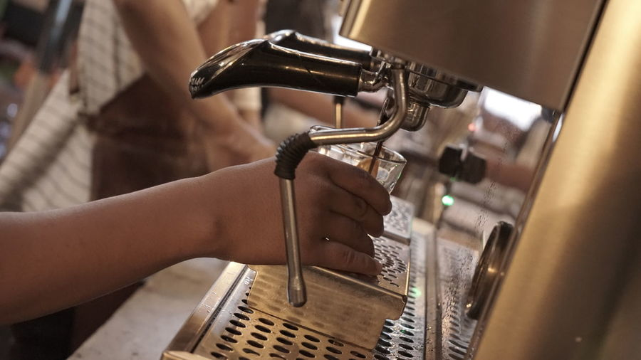Adult Business Close-up Coffee Maker Coffee Shop Drink Food And Drink Industry Hand Holding Human Body Part Human Hand Indoors  Machinery Occupation One Person Selective Focus Silver Colored Skill  Small Business Technology Working