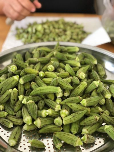High angle view of okras in container on table