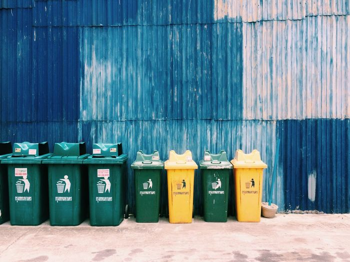 Garbage Bin Environmental Conservation Garbage Can In A Row Day Architecture Environmental Issues No People Environment Garbage Outdoors Multi Colored Drum - Container