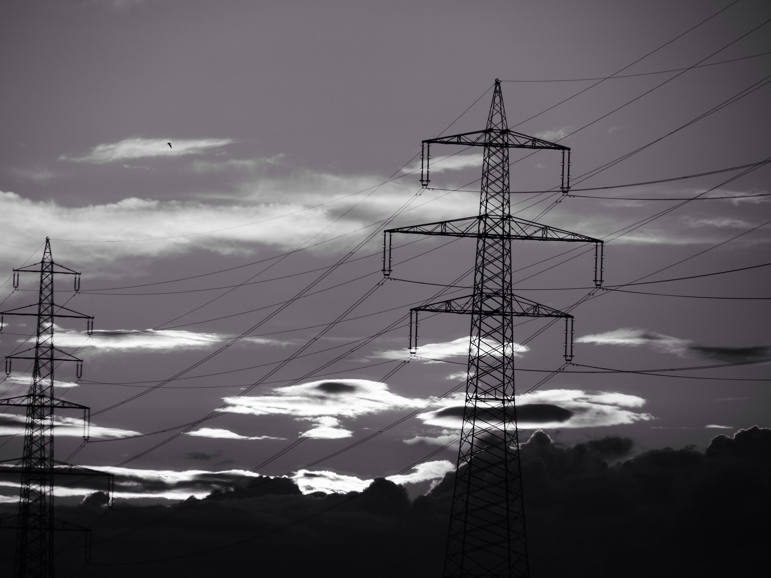 electricity pylon, power line, electricity, power supply, fuel and power generation, technology, cable, connection, sky, low angle view, silhouette, cloud - sky, power cable, electricity tower, outdoors, no people, complexity, dusk, nature, telephone line