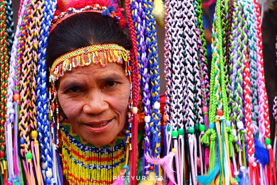 """Pasilip"" A portrait of an adult lumad during the Kadayawan sa Davao Festival, She is participating the Pamulak sa Kadalanan event and celebration. Fujifilm XT100 7artisans Randomphotos Composition Hobbyistphotographer Fuji Ndfiltered Philippines Photographer Landscapephotography Newbie Streetphotographyworldwide Lensculture Street_focus_on Streets_storytelling Streetphotography Streetsleaks Streetphotographycommunit Streetclassics Portrait Smiling Multi Colored Cheerful Happiness Looking At Camera Wool Headshot Human Face Textile"