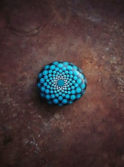 Painting beach rocks is my new found hobby. Blue Green Aqua Optical Illusions Hand Painted Mandala Beach Rock Rusty Metal Outdoors Afternoon