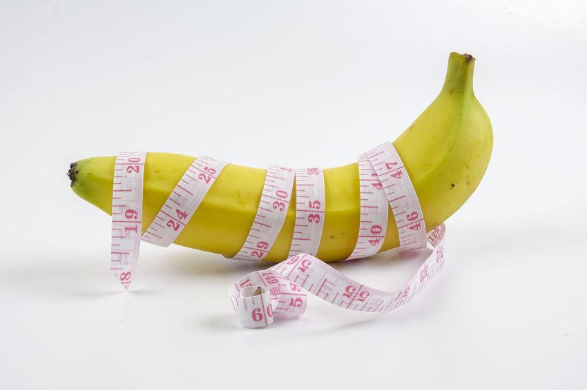 Banana and measuring tape. Men health Banana Measuring Tape Men Health Close-up Erection_ No People Studio Shot Testosterone White Background