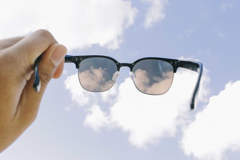 Close-up Cloud - Sky Day Eyeglasses  Eyewear Holding Human Body Part Human Hand Men One Man Only One Person Outdoors People Real People Sky Sunglasses Vision