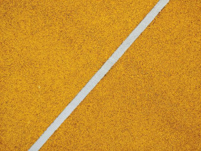 High angle view of yellow basketball court