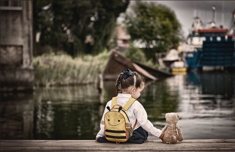 Silence Girl Bear sea Nikon Real People River Water Outdoors People Childhood Sitting Day One Person Tree Boat 24 pNikonLifeiNikonphotograhyaNikon DslrsNikonchileile First Eyeem Photo