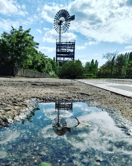 windmill in Landschaftspark Duisburg-nord #windmill #reflection #mirror #mirror #windmills #photography Water Puddle Reflection Sky Cloud - Sky