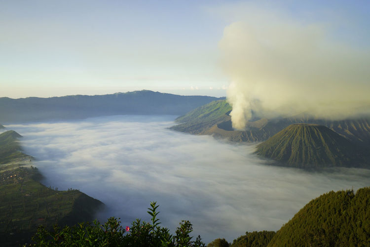 top view volcano with mountain and mist, from Indonesia Mountain Beauty In Nature Sky Volcano Scenics - Nature Smoke - Physical Structure Tranquil Scene Erupting Non-urban Scene Tranquility No People Environment Active Volcano Geology Nature Land Cloud - Sky Landscape Volcanic Crater Day Outdoors Power In Nature Air Pollution Pollution