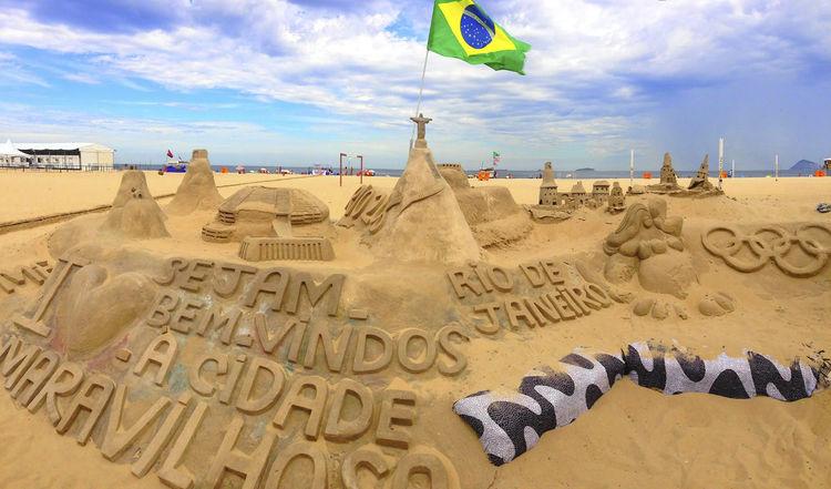 sand sculpture in rio de janeiro with flag BEMVINDO Rio De Janeiro Beach Sculpture Brasilian Flag Ciudade Maravilhosa Flag No People Sand