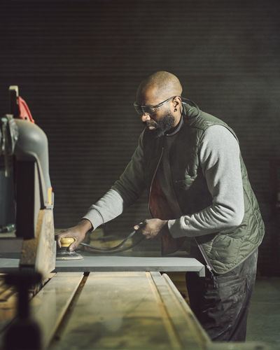 Carpenter working at workshop