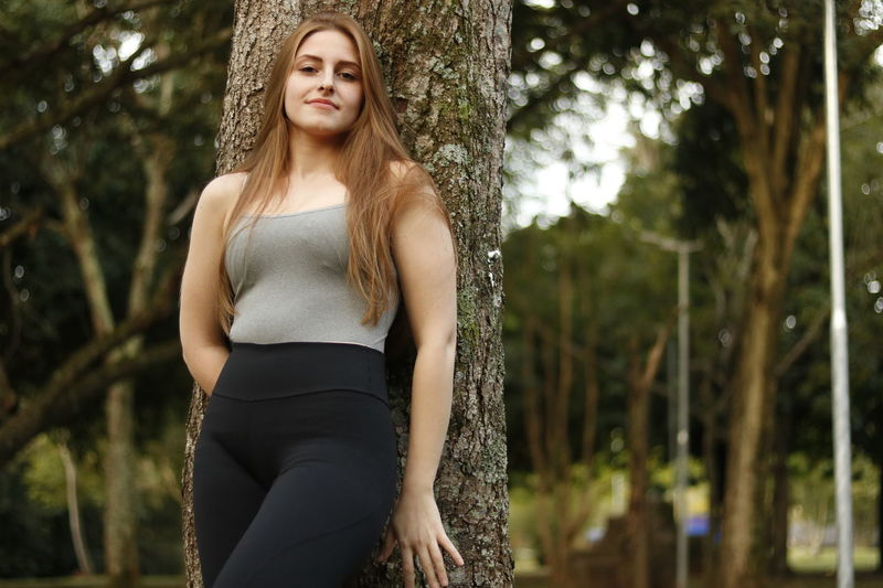 Active Beautiful Woman Day Fashion Focus On Foreground Front View Leggings Leisure Activity Lifestyles Looking At Camera Nature One Person Outdoors Portrait Real People Sexygirl Sportive Sports Standing Three Quarter Length Tree Tree Trunk Young Adult Young Women