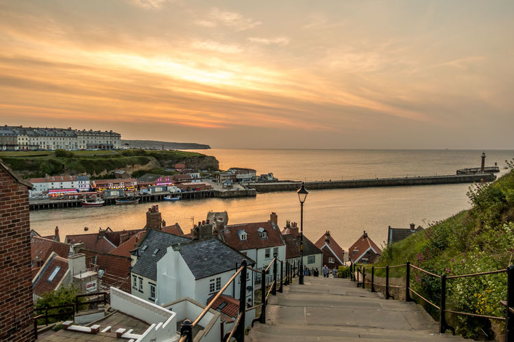 Whitby Whitby Harbour Whitby View Whitby North Yorkshire North Yorkshire North Yorkshire Coast Seaside Seaside Town Coastal Water Sky Sunset Sea Horizon Over Water Horizon Orange Color Building No People Outdoors High Angle View Built Structure Scenics - Nature Building Exterior Cloud - Sky