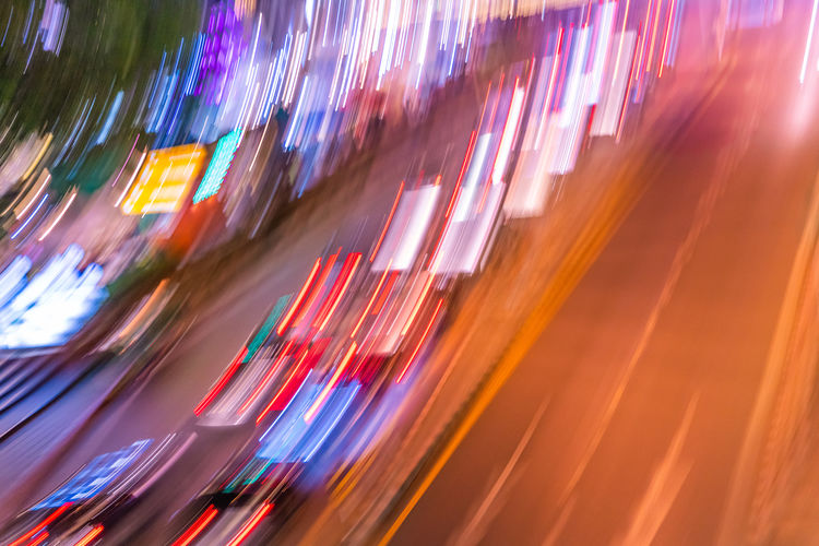 Traffic Car Traffic Jam Slow Shutter Illuminated Light Street Road Abstract Motion Blurred Motion Speed Long Exposure No People Multi Colored City Panoramic Light Trail Night Transportation Light - Natural Phenomenon Architecture Business Defocused Outdoors Glowing Tilt Flowing Nightlife Fiber Optic