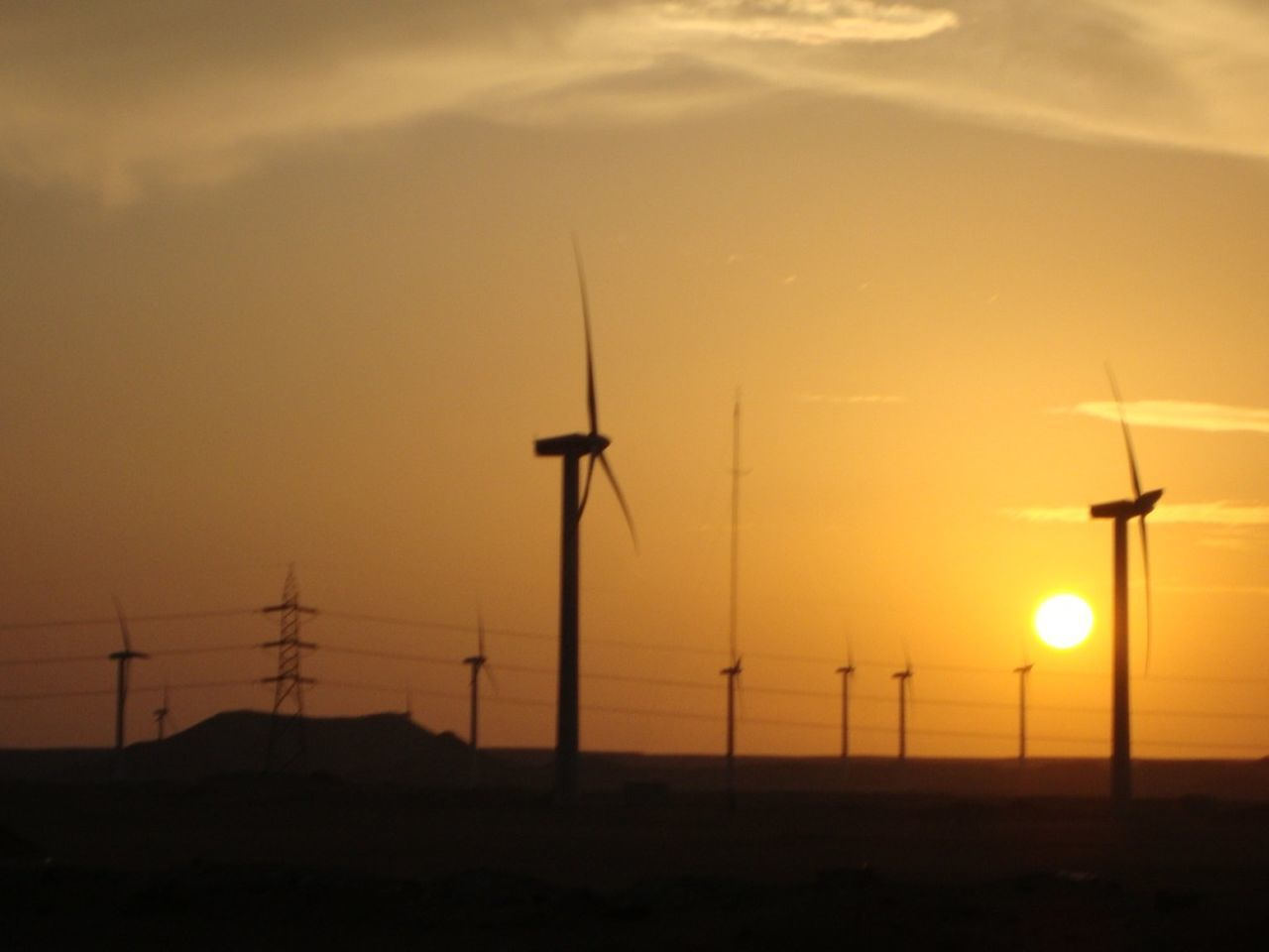 environmental conservation, alternative energy, wind turbine, wind power, fuel and power generation, renewable energy, sunset, windmill, technology, industrial windmill, electricity, orange color, silhouette, nature, no people, outdoors, sky, low angle view, beauty in nature, tranquil scene, tranquility, rural scene, sustainable resources, scenics, traditional windmill, day