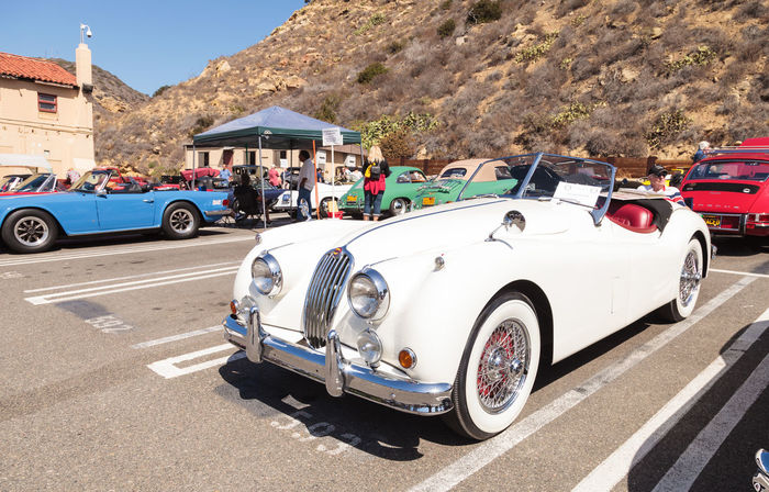 Laguna Beach, CA, USA - October 2, 2016: White 1956 Jaguar XK 140 MC formerly owned by Alex Trebek and now owned Robert Huntington and displayed at the Rotary Club of Laguna Beach 2016 Classic Car Show. Editorial use. 140 1956 Alex Trebek Car Show Classic Car Classic Car Show Classic Cars Day JAGUAR Jaguar XK 150 Laguna Beach MC Old Car Outdoors Vintage Car