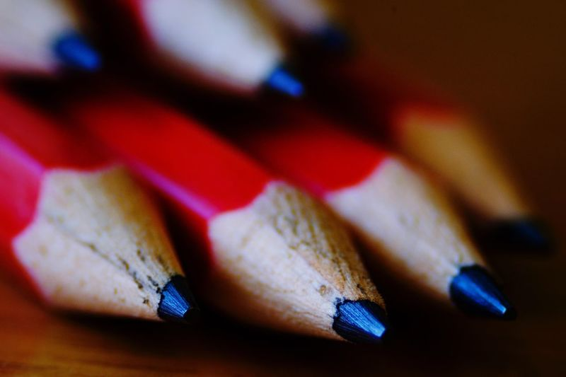 Close-up of red pencils on table