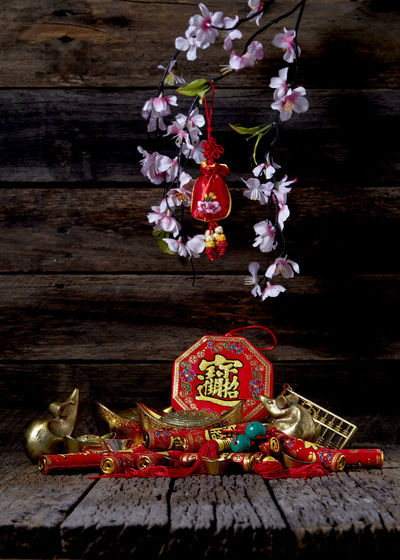 """Happy Chinese new year 2020 year of the rat or lunar new year, Good luck decoration of festive decorations on Old wooden table , copy space for text, (with the character """"fu"""" meaning fortune) Chinese New Year Lunar New Year Good Luck Decoration Festive Wooden Table Luck Mascot Flat Lay Celebration Craft Firecrackers Ornament Gold China 2020 2019 Pig Minimal Sales Envelope Celebrations Flowers Lucky Tradition Symbol Red Fu Background Festival Spring Holiday Traditional Gold Culture Oriental Fortune Asian  ASIA Packet Plum Blossom Design Celebrate Greeting Prosperity Auspicious Money Happiness Firecracker Ingot Flower Flowering Plant Wood - Material Plant No People Indoors  Religion Text Still Life Spirituality Art And Craft Nature Belief"""