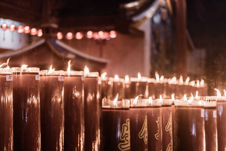 Illuminated candles in temple