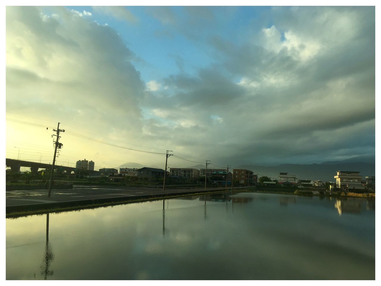 sky, reflection, water, cloud - sky, built structure, no people, architecture, building exterior, outdoors, waterfront, city, industry, day, electricity pylon, nature