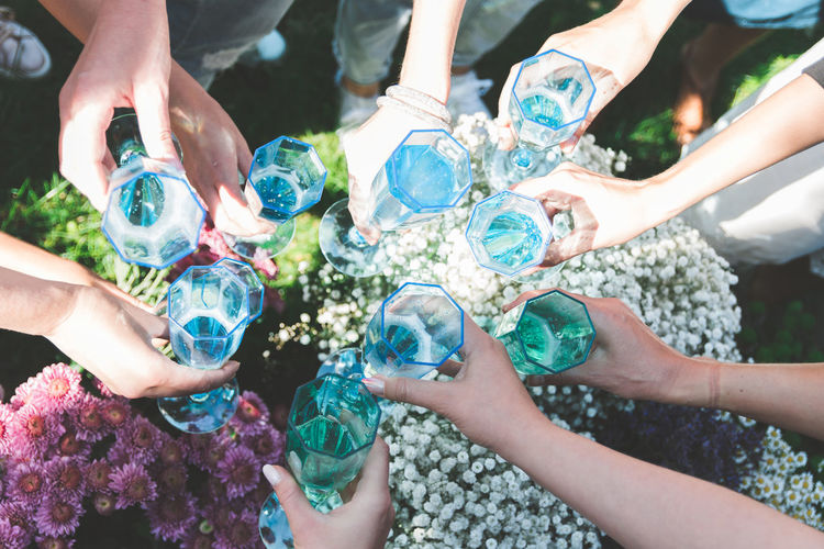 Group Of People Human Hand Hand Friendship Real People Human Body Part Togetherness High Angle View Lifestyles Women Day Holding Men People Medium Group Of People Nature Adult Glass Leisure Activity Celebration Finger Flower Wreath Girls Party