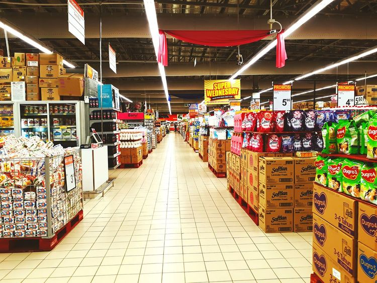 in a hypermarket food and drink section Multi Colored Hanging For Sale Display Retail Display Price Tag Arrangement Market