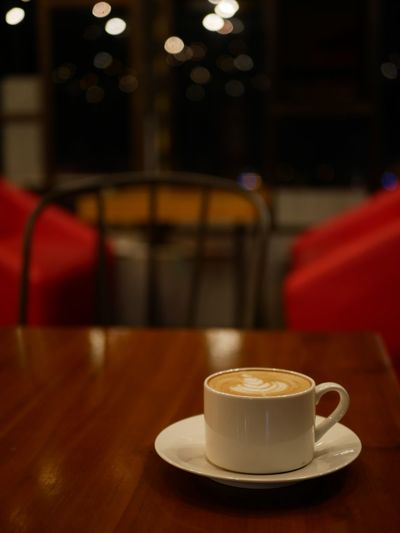 Coffee cup on table at cafe