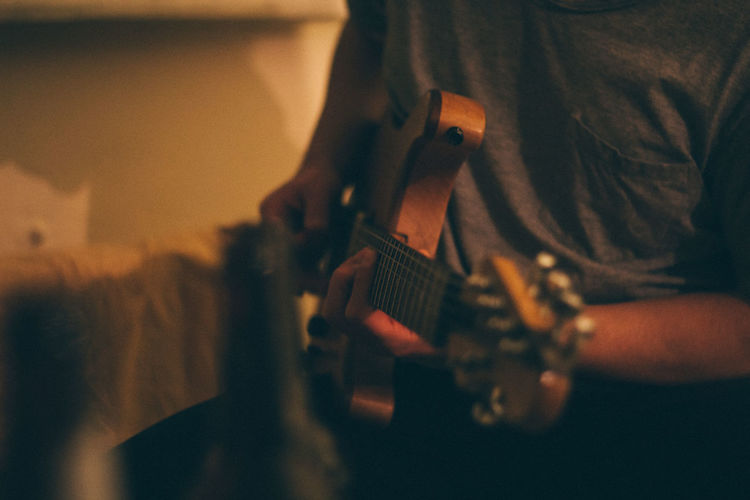 50mm Arts Culture And Entertainment Canon Canon600D Canonphotography Depth Of Field Guitar Hobbies Holding Human Body Part Indoors  Lifestyles Music Musical Instrument Musician Occupation Part Of Playing Real People Selective Focus Sitting Skill  VSCO Vscofilm