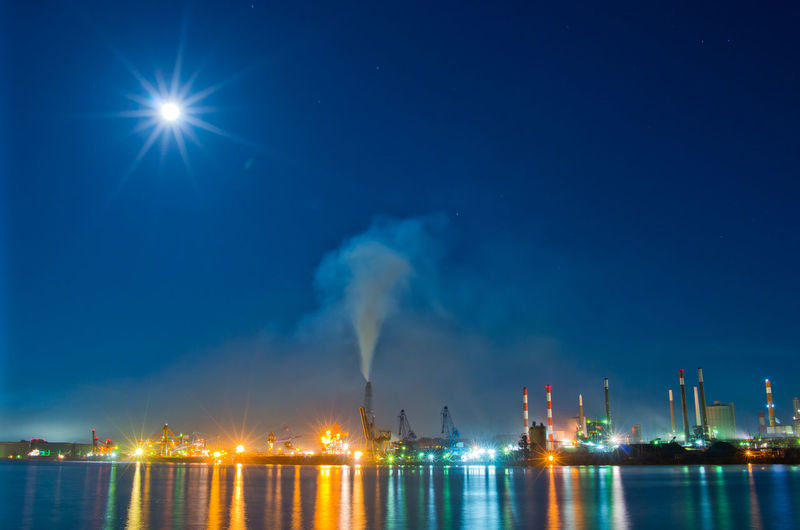 Industry Illuminated Building Exterior Night Pollution Sky Water Smoke - Physical Structure Nature Architecture Environmental Issues Factory Smoke Stack Air Pollution Fuel And Power Generation Environment Waterfront No People Built Structure Outdoors Fumes Cooling Tower Moon Moon Light Japan