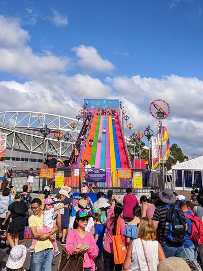 Easter Amusement Park Ride Ferris Wheel Crowd Multi Colored Arts Culture And Entertainment Amusement Park City Traveling Carnival Rollercoaster Fun