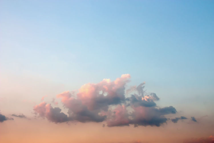 Dramatic atmosphere closeup view of beautiful twilight sky and clouds. Beauty In Nature Blue Cloud - Sky Copy Space Day Dramatic Sky Environment Full Frame Idyllic Low Angle View Motion Nature No People Orange Color Outdoors Scenics - Nature Sky Sunset Tranquil Scene Tranquility