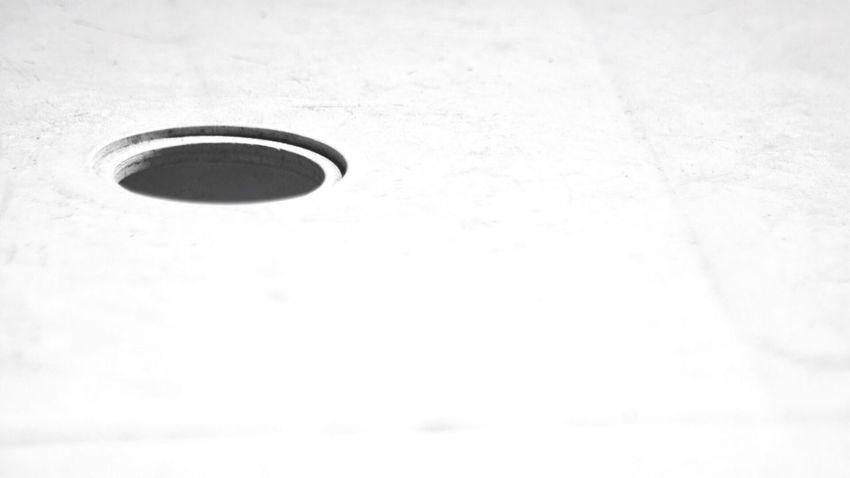 The hole. No People Indoors  Day Holes Table Blackandwhite Black And White Brake The Mold Umbrella Sun Umbrella Hole Break The Mold
