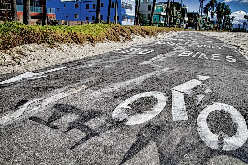 Bike lanes. Bike lane in suburb area with bike lane icon indicated. Bike lane sign on asphalt road. America Beach Beachphotography Bike Bike Lane Blue Sky Blue Sky And Clouds California California Coast Communication Day EyeEm Best Shots EyeEm Five Senses EyeEm Gallery Road Road Sign Santa Monica Santa Monica Pier Signboard Stockphoto Stockphotography Street Tree USA