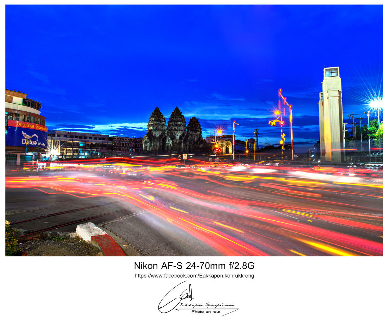 auto post production filter, long exposure, light trail, blurred motion, night, motion, street, speed, city, illuminated, outdoors, text, road, building exterior, city life, clear sky, transportation, street light, architecture, no people, sky, urban scene, high street, road sign, neon