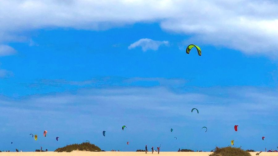 Canary Islands Life Corralejo, Fuerteventura Sky Cloud - Sky Nature Flying Adventure Sport Blue Real People Day Water Extreme Sports Lifestyles Sea Mid-air Leisure Activity
