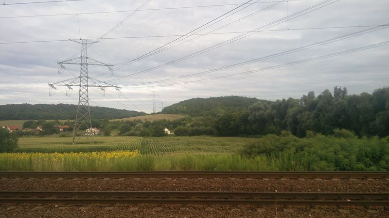 The hills of Mende. Mende, Hungary Hills Green Scenery Electric Tower  Cloudy Trees Sunflowers Meadow Train Tracks
