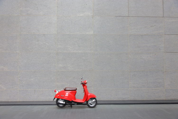 Bangkok, Thailand - June 11, 2018: Suzuki Verde Red Scooter on the streets of Bangkok Thailand. - Image Transportation Mode Of Transportation Land Vehicle Day Wall - Building Feature One Person Architecture Side View Red Single Object Outdoors Built Structure Travel Business City Copy Space Occupation Concrete Design Red Red Motorcycle Bike Class Motorcycle Ride Style Suzuki Transportation Vintage Urban Scooter Parking Race Moto X Extreme Fast City Verde Wall Town