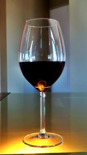 Single glass or red wine in classic glass. Alcohol Close-up Focus On Foreground Glass Of Wine Illuminated No People Red Wine Refreshment Selective Focus Shiraz🍷 Still Life Wineglass